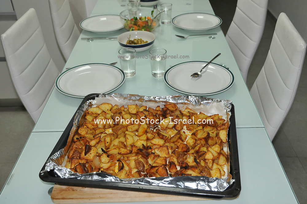 Home made baked potatoes on a table set for a meal
