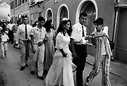 "Wedding in Muslim East Mostar as life returns to normal after the Dayton Peace Accords.  It wasdestroyed by systemic bombardment from Croat guns during the Croat Muslim War, when the Croats endeavored to "" cleanse"" the town of non Croats. Mostar, Bosnia and Herzegovina."