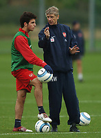 Photo: Javier Garcia/Digitalsport<br /> 01/11/2004 Arsenal Champions League Training, London Colney<br /> Arsene Wenger chats to Cesc Fabregas during a break in training