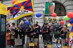 "London, September 21st 2015. Protests by Shugden Buddhists who allege that the Dalai Lama discriminates against their sect, protest outside the Lyceum Theatre in London as the Dalai Lama attends ""An Afternoon With The Dalai Lama And Friends"" event as part of his UK visit. Loyalists staged a counter protest welcoming the Buddhist leader to London. PICTURED: Dalai Lama loyalists protest against the Shugden Buddhists accusations against their leader."