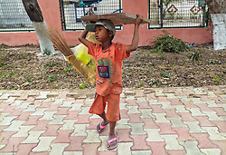 May 1, 2019 - Punjab, Punjab, India - A young labourer seen walking along a park on the eve of International Labour Day in Punjab, India..International Labour Day also known as May Day is marked across the world on May 1. The International Labour Day commemorates the historic struggle of working people throughout the world. (Credit Image: © Saqib Majeed/SOPA Images via ZUMA Wire)