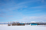 Quaint farm and homestead home in snowy landscape in Iceland
