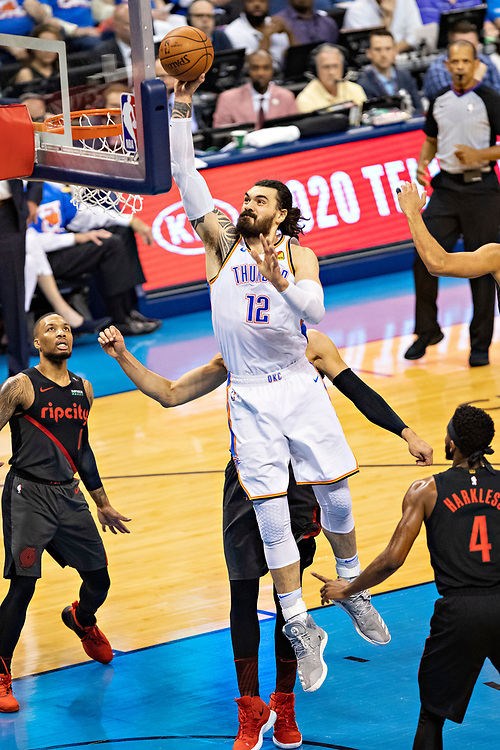 OKLAHOMA CITY, OK - APRIL 21: Steven Adams #12 of the Oklahoma City Thunder goes up for a dunk during a game against the Portland Trail Blazers during Round One Game Three of the 2019 NBA Playoffs on April 21, 2019 at Chesapeake Energy Arena in Oklahoma City, Oklahoma  NOTE TO USER: User expressly acknowledges and agrees that, by downloading and or using this photograph, User is consenting to the terms and conditions of the Getty Images License Agreement.  The Trail Blazers defeated the Thunder 111-98.  (Photo by Wesley Hitt/Getty Images) *** Local Caption *** Steven Adams