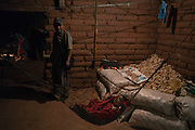 JANUARY 27: Bernardino Sánchez, founder of the Regional Coordinator of Community Authorities (CRAC-PF) community police force, watches her younger daughter sleep while his wife, Adelo Virgeño, prepares tortillas in their home in Rincón de Chautla, Guerrero state, Mexico. Murders in Mexico rose to a new record in 2019, the first full year of Andres Manuel Lopez Obrador's presidency, posing a challenge to the popular leader to make good on a campaign promise of reducing violence.