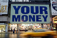 Aug 04, 2003; New York, NY, USA; Large two story sign saying YOUR MONEY up over busy city streets in Times Square.  People move along on the streets and cabs without taking notice. Scenic view of New York City.