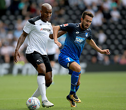 Derby County's Andre Wisdom (Left) and TSG 1899 Hoffenheim's Lukas Rupp battles for the ball.