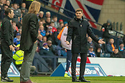 Hearts Interim Manager Austin MacPhee makes notes while Rangers Manager Steven Gerrard expresses his dissatisfaction during the Betfred Scottish League Cup semi-final match between Rangers and Heart of Midlothian at Hampden Park, Glasgow, United Kingdom on 3 November 2019.
