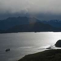 Chilean cruise ship Mare Australis anchors in Wulaia Bay on Navarino Island, Tierra del Fuego, Chile.  The Murray Channel and Hoste Island are in background.