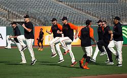 Oct 7, 2021; San Francisco, CA, USA; San Francisco Giants players limber up during NLDS workouts. Mandatory Credit: D. Ross Cameron-USA TODAY Sports