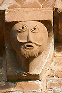 Norman Romanesque exterior corbel no 31 - sculpture of a man with a goatee beard. The Norman Romanesque Church of St Mary and St David, Kilpeck Herefordshire, England. Built around 1140 .<br /> <br /> Visit our MEDIEVAL PHOTO COLLECTIONS for more   photos  to download or buy as prints https://funkystock.photoshelter.com/gallery-collection/Medieval-Middle-Ages-Historic-Places-Arcaeological-Sites-Pictures-Images-of/C0000B5ZA54_WD0s