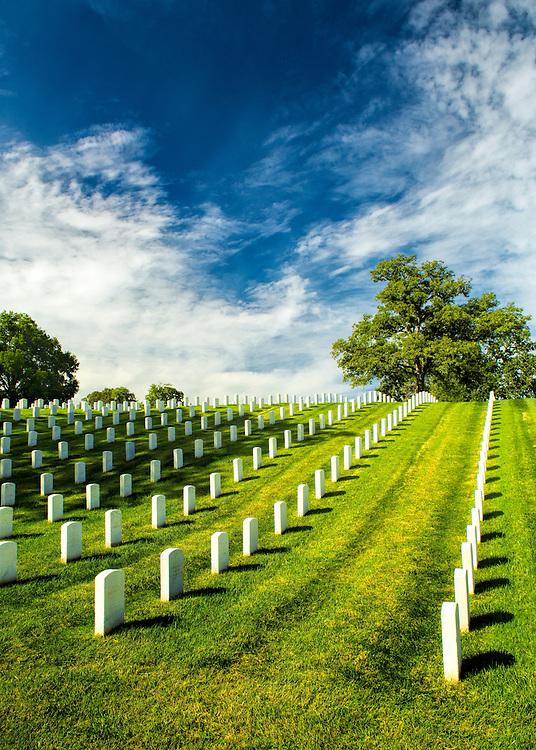 Sunshine basks the graves under midday sun at Jefferson Barracks National Cemetery