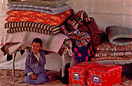 Bedding folded and stored in the majlis area of the bayt (tent) of the Shamar in the Nafud, Saudi Arabia