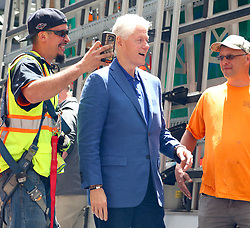 EXCLUSIVE: Bill Clinton takes the time to chat and take selfies with New York City contruction workers and even greets a homeless man in Madison Square Park, NYC. 03 Jun 2017 Pictured: Bill Clinton. Photo credit: MEGA TheMegaAgency.com +1 888 505 6342