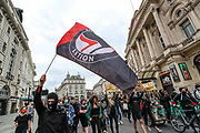 People take part in a demonstration in Central London on Monday, June 29, 2020. Protestors chanted slogans against police racism and racial injustice, also they called against newly proposed immigration Bill in, which gives the power to the government to indefinitely detain refugees, asylum seekers or people the government wishes to deport. The bill also will repeal EU freedom of movement, and means migration will operate under strict new points-based system and is due to be passed on Tuesday, June 30, 2020, in the House of Commons. (Photo/ Vudi Xhymshiti)