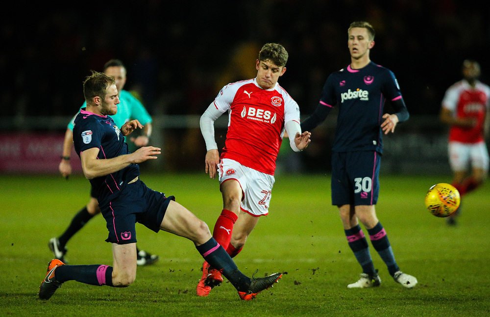 Fleetwood Town's Harrison Biggins is tackled by Portsmouth's Matthew Clarke<br /> <br /> Photographer Alex Dodd/CameraSport<br /> <br /> The EFL Sky Bet League One - Fleetwood Town v Portsmouth - Tuesday 20th February 2018 - Highbury Stadium - Fleetwood<br /> <br /> World Copyright © 2018 CameraSport. All rights reserved. 43 Linden Ave. Countesthorpe. Leicester. England. LE8 5PG - Tel: +44 (0) 116 277 4147 - admin@camerasport.com - www.camerasport.com