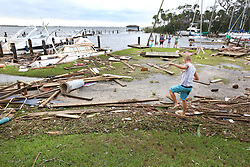 People arrive to the Sundance Marine in Palm Shores, Fla. on Monday, September 11, 2017 to survey the aftermath of hurricane Irma. Eight boats had sunk and many were damaged. Debris from sunken boats and docks washed over the seawall onto the land as Hurricane Irma winds blew from the east. Photo by Orlando Sentinel/TNS/ABACAPRESS.COM