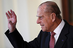 The Duke of Edinburgh bids farewell to Colombia's President Juan Manuel Santos and his wife Maria Clemencia de Santos following their state visit, at Buckingham Palace in London.