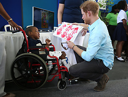 Prince Harry meets Ty Plumber as he attends a conversation projects exhibition, where he will unveil a plaque designating the Castries Water Works Reserve and surrounding rainforest as St Lucia's contribution to The Queen's Commonwealth Canopy Project, on the island of St Lucia during the second leg of his Caribbean tour.