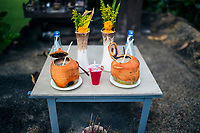 Two coconut shells adorn a small altar on Koh Samui island in southern Thailand.