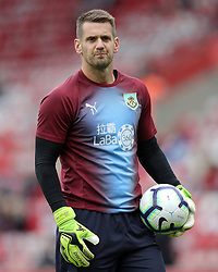 """Burnley goalkeeper Thomas Heaton before the Premier League match at St Mary's, Southampton. PRESS ASSOCIATION Photo. Picture date: Sunday August 12, 2018. See PA story SOCCER Southampton. Photo credit should read: Andrew Matthews/PA Wire. RESTRICTIONS: EDITORIAL USE ONLY No use with unauthorised audio, video, data, fixture lists, club/league logos or """"live"""" services. Online in-match use limited to 120 images, no video emulation. No use in betting, games or single club/league/player publications."""