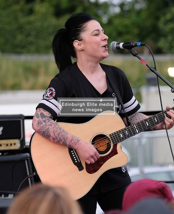 Party at the Palace, Linlithgow, Saturday 12th August 2017<br /> <br /> Lucy Spraggan performs on the Break Out Stage at Party at the Palace 2017.<br /> <br /> The Break Out Stage was sponsored by The Scottish Sun newspaper but Lucy refused to perform unless the banner was removed. Stagehands rolled up the banner so the branding couldn't be seen.<br /> <br /> (c) Alex Todd   Edinburgh Elite media