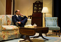 """Marc Willis as Barney Cashman sits alone of the couch during dress rehearsal for """"Last of the Red Hot Lovers"""" with Winnipesaukee Playhouse on Wednesday afternoon.  (Karen Bobotas/for the Laconia Daily Sun)"""