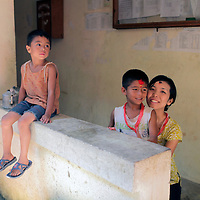 Asia, Nepal, Kirtipur. Local mother and sons of Kirtipur in the Kathmandu Valley.
