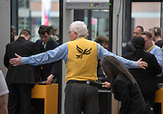 © Licensed to London News Pictures. 15/03/2015. Liverpool, UK  A delegate passes through security. The Liberal Democrat Spring Conference in Liverpool 15th March 2015. Photo credit : Stephen Simpson/LNP