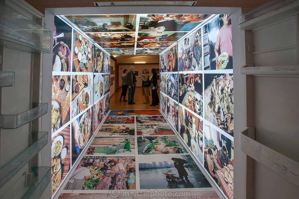 Barcelona, Spain. Exhibition curated to look like a walk-through refrigerator with food photos from Material World: A Global Family Portrait. The exhibition continues through other rooms.