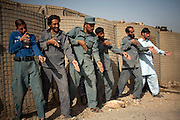 A Afghan policemen simulate weapons orientation during a trainning session with US soldiers from 2nd PLT Diablos 552nd MIlitary Police Company, on the  outskirts of Kandahar City, Afghanistan, Tuesday, Oct. 26, 2010. (AP Photo/Rodrigo Abd)