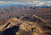 Alaska. Aerial view of Polychrome Mountains and East Fork of the Toklat River, with Sable Mountains in the background, Denali National Park.
