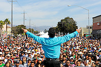 """The lead singer of the popular band """"Tentacion"""" takes in the crowd's appreciation just before the reenactment of """"El Grito,"""" or """"The Cry of Independence"""" in Salinas. Sunday's crowds along East Alisal celebrated the symbolic beginning of Mexico's revolution against Spanish rule."""