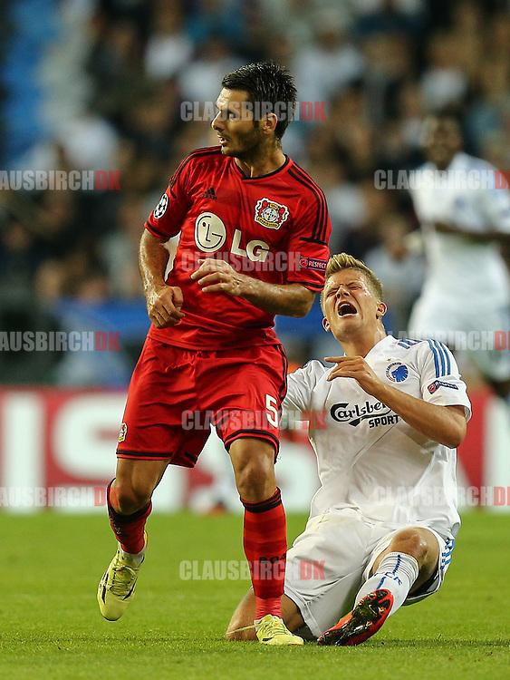 FODBOLD: Andreas Cornelius (FC København) og Emir Spahic (Bayer 04 Leverkusen) under UEFA Champions League Play-Off kampen mellem FC København og Bayer 04 Leverkusen den 19. august 2014 i Parken, København. Foto: Claus Birch.