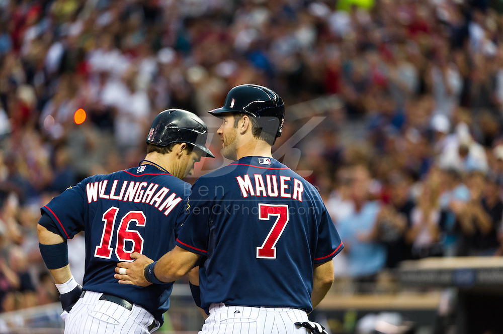 Minnesota Twins left fielder Josh Willingham is congratulated by his teammate Joe Mauer after hitting his 2nd of 2 home runs against the Oakland Athletics on July 13, 2012 at Target Field in Minneapolis, Minnesota.  The Athletics defeated the Twins 6 to 3.  © 2012 Ben Krause