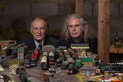Brothers Simon, 53 and Paul Hurst, 58 have some of their late father's ashes carried around his extensive model railway in the loft of his home. PICTURED: Paul, left and Simon in the loft with their their father's model railway. Leeds, Kent, March 15 2018.