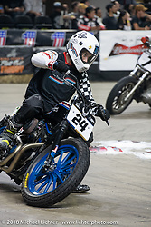 Tj Tucker on his 1999 Harley-Davidson Sportster races through turn one at the Flat Out Friday flat track racing on the Dr. Pepper-covered track in the UW-Milwaukee Panther Arena during the Harley-Davidson 115th Anniversary Celebration event. Milwaukee, WI. USA. Friday August 31, 2018. Photography ©2018 Michael Lichter.