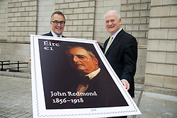 06 March 2018<br /> <br /> John Bruton unveiled a new stamp, marking the centenary of the death of John Redmond, at a symposium on Redmond in the National Gallery of Ireland today (Tuesday).<br /> <br /> Pictured (L-R) David McRedmond, An Post Group CEO and former Taoiseach John Bruton.<br /> <br /> Photo: Lensmen