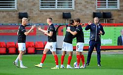Cheltenham Town platers finish their warm up session prior to kick-off- Mandatory by-line: Nizaam Jones/JMP - 10/10/2020 - FOOTBALL - Jonny-Rocks Stadium - Cheltenham, England - Cheltenham Town v Crawley Town - Sky Bet League Two
