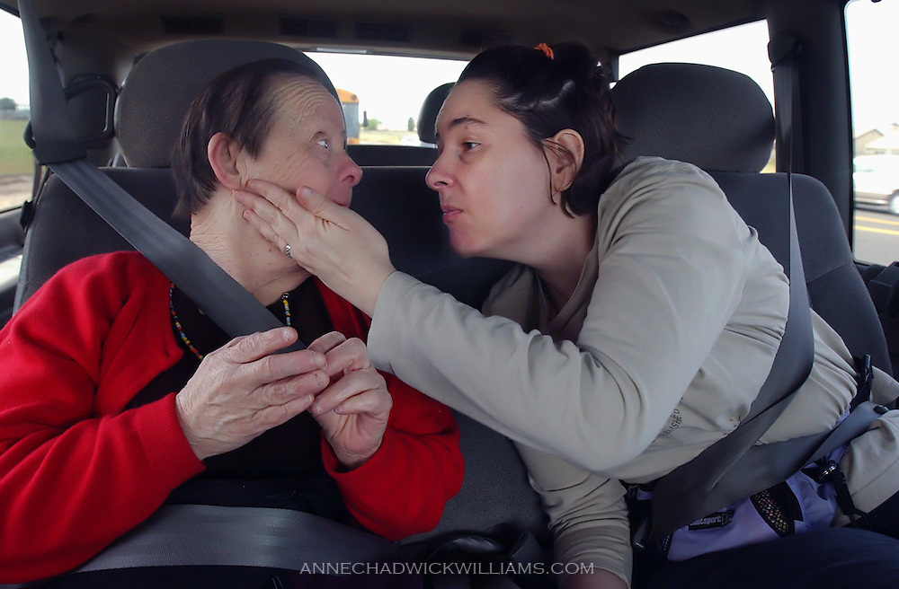 Irene Pinole is one of the oldest people with Down Syndrome. Terry Gordon gives her group home roommate a caress, then a kiss, on the way back from clothes shopping. Anne Chadwick Williams /May  2004 /Sacramento Bee