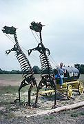 A farmer/sculptor near Fort Collins, assembled this sculpture of dinosaurs hauling an oil wagon.