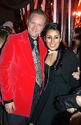 JOE CORRE son of Vivienne Westwood, his wife SERENA REES at a party and fashion show by Agent Provocateur at the Cafe de Paris, Coventry Street, London W1 on 14th February 2005.<br /><br />NON EXCLUSIVE - WORLD RIGHTS