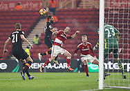 Ahmed Elmohamady of Hull City tussles with Adam Forshaw of Middlesbrough in the air during the English Premier League match at Riverside Stadium, Middlesbrough. Picture date: December 5th, 2016. Pic Jamie Tyerman/Sportimage