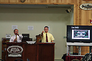 Auctioneer Dudley Browne (left) and unidentified asssociate at the October 2010 Firearms Auction.