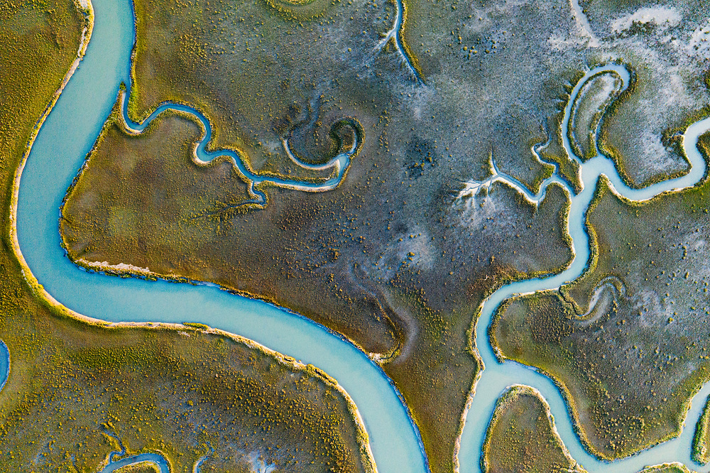 An aerial image showing the beautiful patterns formed in the Mockhorn Island State Wildlife Management Area, a marshland off Oyster, Virginia, USA.