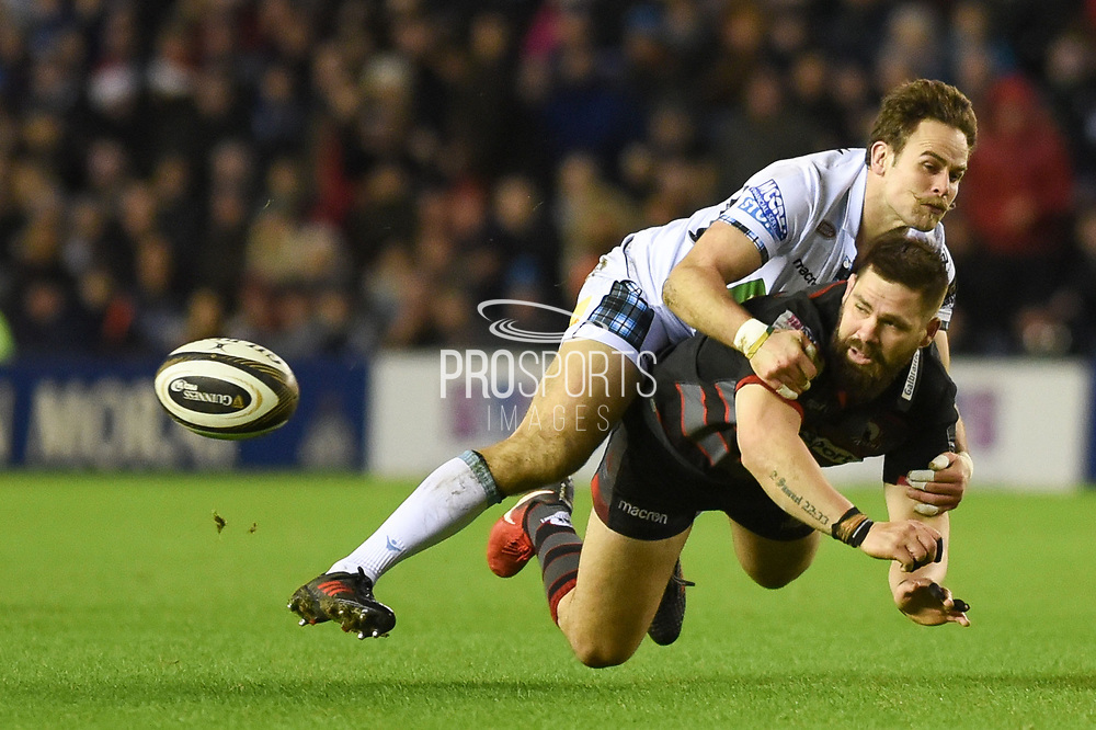 Rory Sutherland gets a pass away while tackled by Ruaridh Jackson during the Guinness Pro 14 2017_18 match between Edinburgh Rugby and Glasgow Warriors at Murrayfield, Edinburgh, Scotland on 23 December 2017. Photo by Kevin Murray.