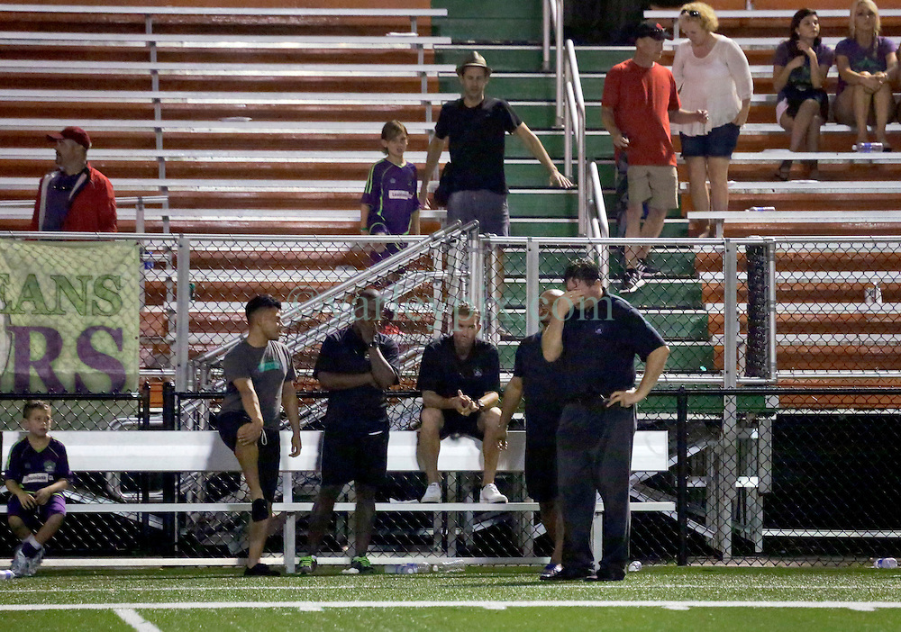24 June 2015. New Orleans, Louisiana.<br /> National Premier Soccer League. NPSL. <br /> Jesters 0 - Atlanta Silverbacks 1.<br /> Head coach Kenny Farrell shows his disappointment at home in the Pan American Stadium. <br /> Photo©; Charlie Varley/varleypix.com