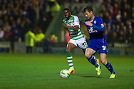 Joel Grant of Yeovil Town (L) chases David Nugent of Leicester City (R) during the Skybet Championship match, Yeovil Town v Leicester City at Huish Park Stadium in Yeovil on Tuesday 1st October 2013. Picture by Sophie Elbourn, Andrew Orchard Sports Photography,