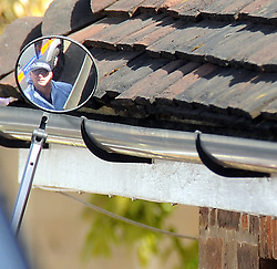 © Licensed to London News Pictures. 21/05/2015<br /> A police officer search the guttering.<br /> Met police search teams arriving early this morning (21.05.2015) at the Dartford home of Brian and Paul Reader.<br /> Eight men, including two from Kent, have been charged in connection with the multimillion pound jewellery heist at Hatton Garden.<br /> <br />  Brian Reader and his son Paul Reader both of Dartford Road, Dartford,Kent have been charged with conspiracy to burgle.  <br /> <br />  <br /> (Byline:Grant Falvey/LNP)