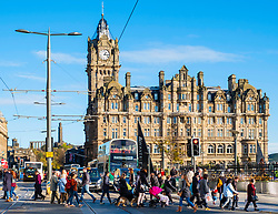 View along Princes street to the  Balmoral Hotel with busy pedestrian crossing Edinburgh , Scotland, United Kingdom.