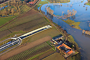 Nederland, Limburg, Roermond, 2011-01-10; Roerdal met riviertje de Roer, ten zuiden van Roermond. Door het hoogwater zijn landerijen onder water te komen staan. Links door beeld de ingang van de Roertunnel..Valley of River Roer, south of Roermond. Because of the high water the land is submerged. High water due to snow melt and precipitation upstream. .Notice entrance tunnel..luchtfoto (toeslag), aerial photo (additional fee required).foto/photo Siebe Swart